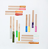 Wooden sticks with paint samples on ends