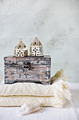 Wooden box and Oriental lanterns on folded blanket