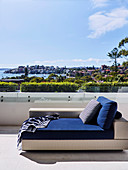 Day bed with blue overlay on roof terrace