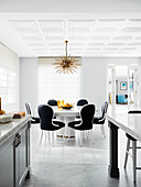Elegant dining area with a round table and designer chairs