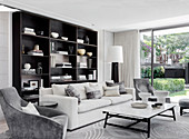 Elegant living room with upholstered furniture and shelves