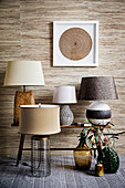 Various table lamps in shades of brown against a wallpaper