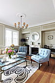 Light blue upholstered chairs in the living room with gray walls