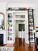 Built-in bookcase with library manager around the door