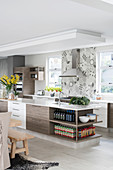 Groceries on shelves of island counter in modern, open-plan kitchen