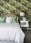 Wallpaper with pattern of tropical leaves in classic bedroom