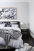 Bedroom in shades of gray with natural decoration
