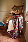 Floral blanket draped over Windsor armchair