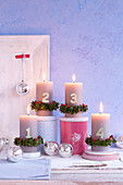 Advent candles decorated with number and box wreaths