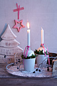 Christmas baubles used as festive candlesticks