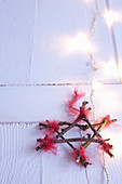 Star handmade from twigs tied with frayed red wool