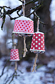 Bird feeders handmade from paper cups filled with bird food