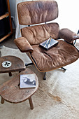 Classic leather armchair and set of wooden side tables