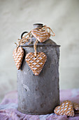 Heart-shaped pendants with waffle structure on old metal churn