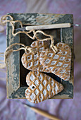 Heart-shaped pendants with waffle structure on top of box with peeling paint