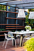 Modern garden furniture on the covered terrace in gray