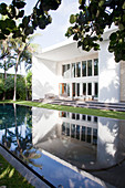 View from garden of luxurious architect-designed house with pool