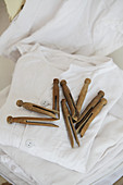 Vintage-style dolly pegs on stacked laundry
