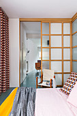 Lattice sliding door in retro-style bedroom