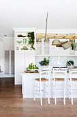 Ladder as hanging storage in the open country kitchen