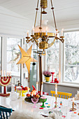 Festively decorated dining table in Scandinavian conservatory