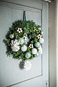 Festive door wreath with paper snowflakes and baubles