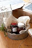 Homemade jam in vintage cake tin as Christmas gift