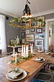 Wreath hung above table set for Christmas in dining room