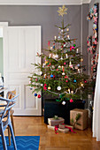 Decorated Christmas tree in dining room
