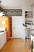 White base cabinets, orange fridge and Christmas decorations in kitchen