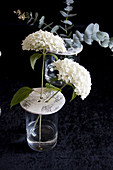 Hydrangeas in vase with perforated lid made from modelling clay