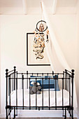 Black crib with canopy and dream catcher
