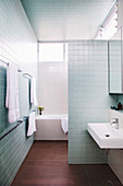 Bathroom with silver-gray wall tiles