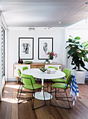 Replica of a classic table with lime green chairs in an open dining area