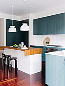 Fitted kitchen with blue-gray lacquered wooden front and kitchen island