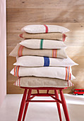 DIY linen cushions with colourful stripes made from tea towels