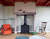 Cast-iron stove in fireplace in living room