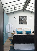Pale blue bedroom in former textile factory