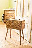 Old sewing box with legs