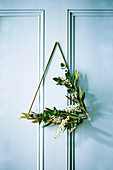 Christmas wreath made of brass triangle