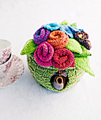 Flower-shaped, knitted warmer for teapot