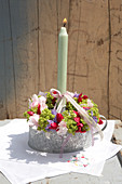 Floral wreath, ribbon and candle in pot with handle