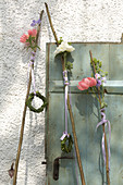Peonies on wooden rods decorating door