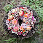 Late-summer wreath of hydrangeas, zinnias and apples