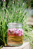 Jar of chive-flower vinegar