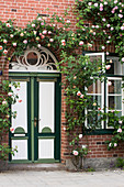 Historic Brick House Planted With Lush Rose Jewelry