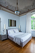 Ceiling fresco in bedroom with arched windows