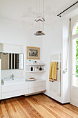 Large, elegant bathroom with balcony door in period building