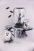 Halloween decorations handmade from jars, branches and cotton wool