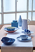 Ceramic bowls, plates, jug, vase and jar with various blue patterns